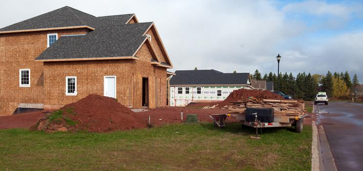 A construction site with a house being built.