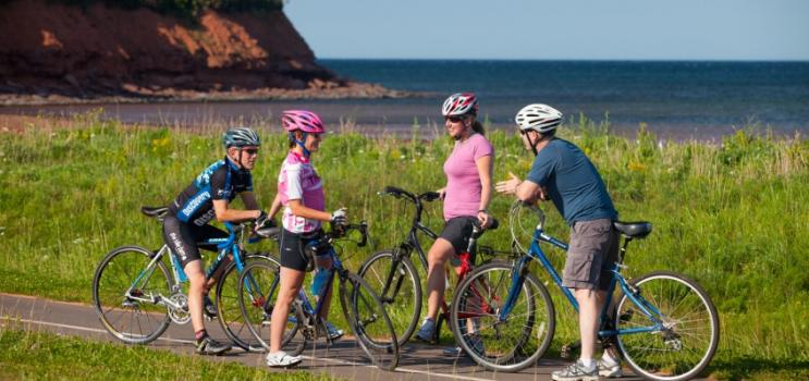 Group of four biking on cycling lane in PEI National Park