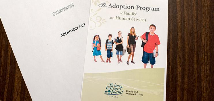 Image of two documents: Adoption Act and PEI Adoption program