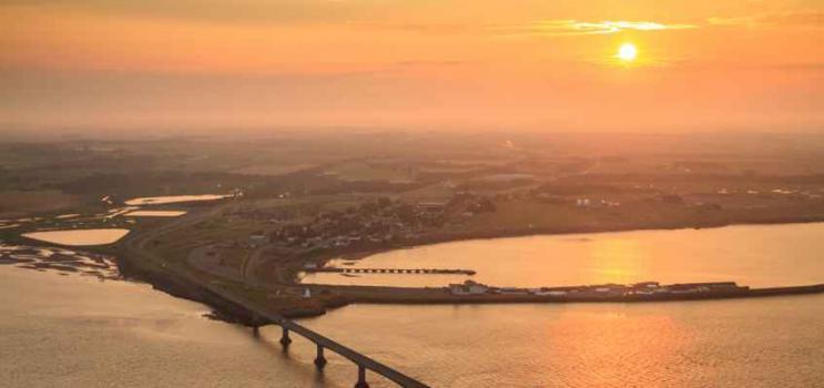 Aerial view of sun setting over Confederation Bridge looking toward Borden-Carleton