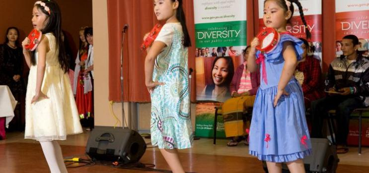 Young girls dance at a diversity festival