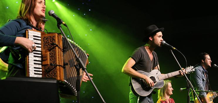 Image of musicians playing music on stage