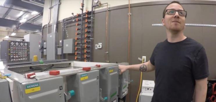 Employee monitors equipment at Aspin Kemp