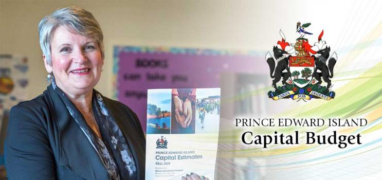 Image of Hon. Darlene Compton, Minister of Finance holding a copy of the PEI Capital Budget 2020