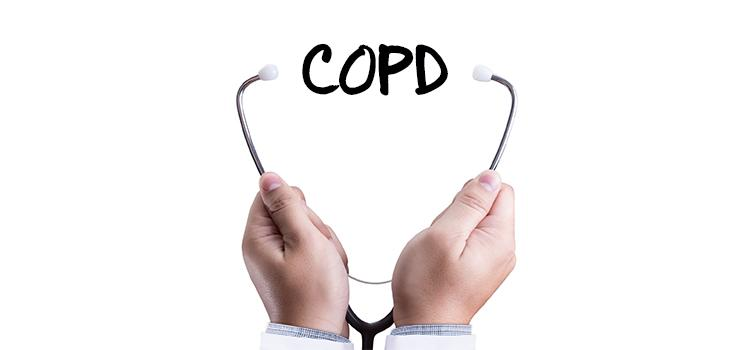 Stethoscope wrapped around the letters COPD (Chronic Obstructive Pulmonary Disease)