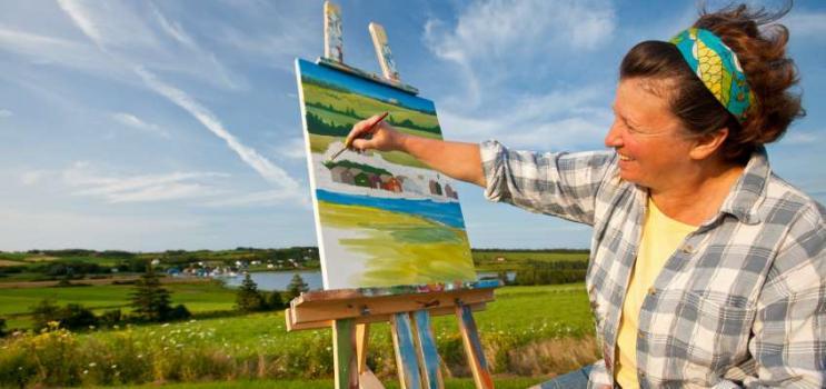 Visual artist works en plein air near the harbour in French River