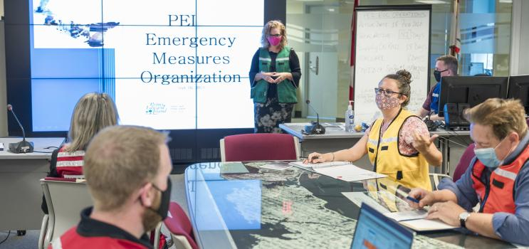 Members of Emergency Measures Organization around planning table