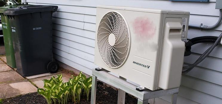 Heat pump on exterior of house