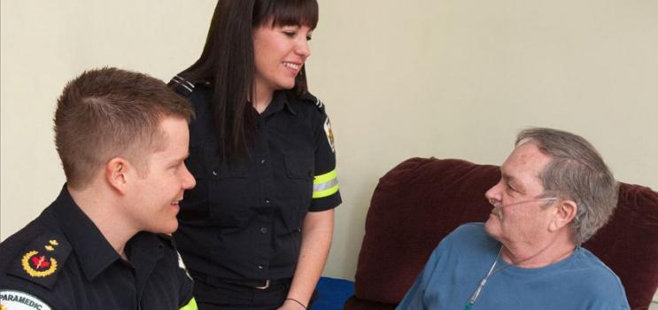 Male and female paramedics with male client