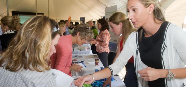 Females interacting at trade show