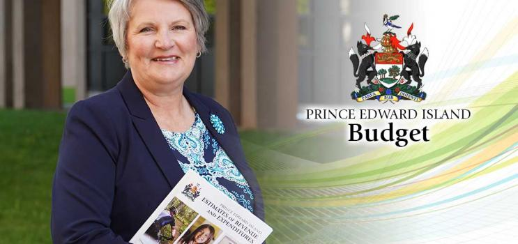 Image of Hon. darlene Compton, Minister of Finance holding 2020/21 budget
