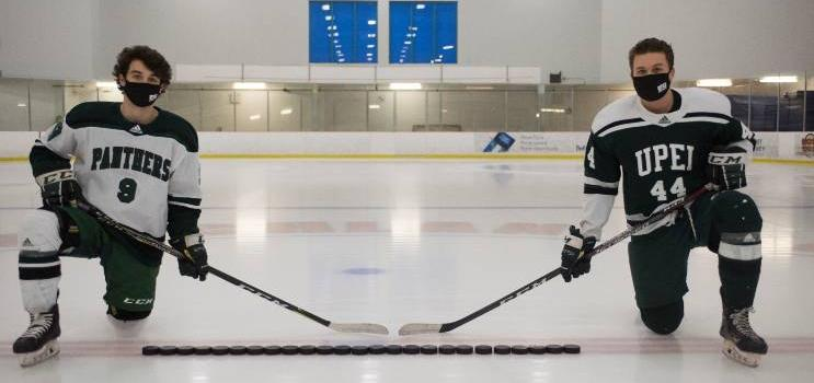 hockey players showing physical distancing using hockey sticks