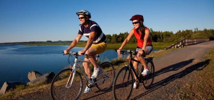 Couple biking on Confederation Trail