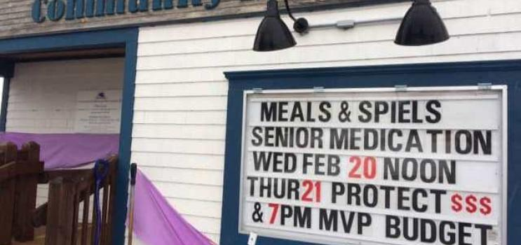 Outdoor sign of Miltonvale Hall announcing seniors program