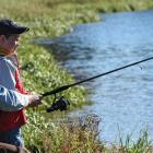 Father and son trout fishing