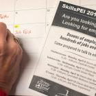 Image of person marking calendar with job fair details