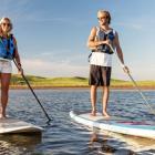Male and female on paddle boards, Prince Edward Island
