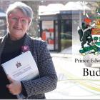 Image of Hon. darlene Compton, Minister of Finance holding 2021/21 budget