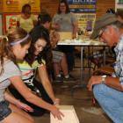 4-H members building a bird house with help from an adult at Rural Youth Fair event