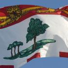 Prince Edward Island flag against a clear blue sky