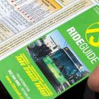 People holding a copy of transit schedule