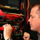 technician working on inside of computer