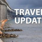 """Image of Confederation Bridge with text """"Travel Update"""""""