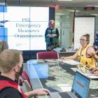 Members of Emergency Measures Organization around planning table