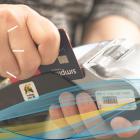Image of customer using debit maching at retailer who sells vaping products