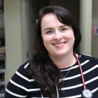 Nurse practitioner with a big smile in clinical setting on PEI