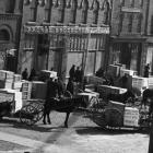 Horses and wagons carrying supplies to a local retail store in Charlottetown, ca. 1899-1906