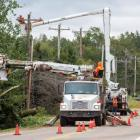 Maritime Electric crew repairing lines after Hurrican Dorian in PEI community