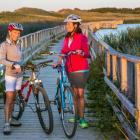 Two women biking at Cavendish Dunelands, PEI