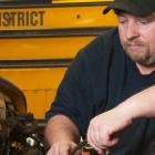 Male heavy duty mechanic working on vehicle