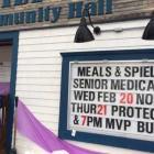 Outdoor sign of Miltonvale Hall announcing seniors program