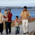 Multi-generational family walks on the boardwalk near Victoria Park