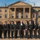 Group of Legislative Assembly of PEI pages and the Speaker of the House stand in front of Province House
