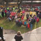 Minister Currie speaks to hundreds of children outside of the legislature.