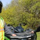PEI ATV Federation president Peter Mellish and Conservation Officer Wade MacKinnon  stand outside beside an All Terrain Vehicle