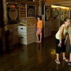 The photo shows four children and one adult looking at exhibits at the Basin Head Fisheries Museum