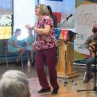 Iain MacInnes and Karine Gallant play while resident care worker Barb Feehan dances for residents of Beach Grove Home.