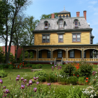 Summer photo of Beaconsfield Historic House at the corner of Kent and West streets.