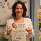 Photo shows Jenny Green holding a blood drive sign