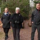 Minister Biggar and two other people walking near newly neamed trail in Bonshaw.