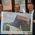 UPEI president Abd-El-Aziz, PEI Premier KIng and MP MacAulay stand holding an artists rendition of the new research centrer