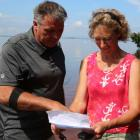 Communities, Land and Environment Minister Robert Mitchell and Megan Harris, Executive Director of the PEI Nature Trust on Courtin Island off Prince Edward Island