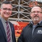 Minister Heath MacDonald stands with Sam Sanderson, general manager of the Construction Association of PEI