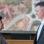 Cornwall Mayor Minerva McCourt and Finance Minister Heath MacDonald stand in front of a map showing where new housing will be built