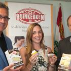 Three people holding Duinkerken food products