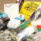 The photo shows a number of items that should be included in an emergency preparedness kit.